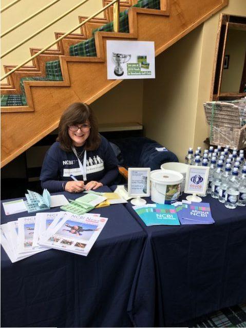 NCBI's Angela at the registration desk