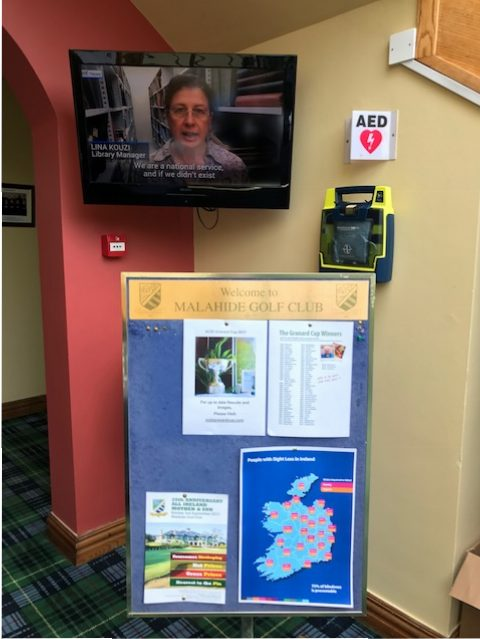 Information noticeboard and NCBI video in background