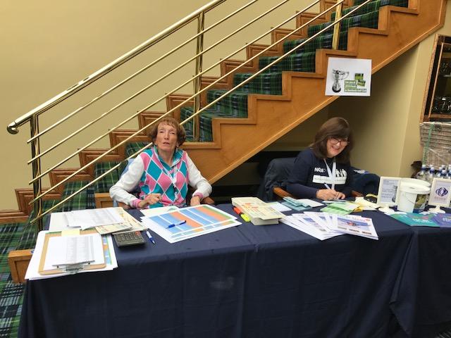 Registration desk with our volunteer and NCBI staff member