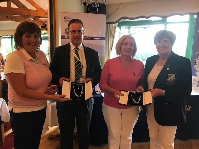Ruairi (NCBI) with Lady Captain (Malahide GC) presenting prizes to Carrick on Shannon GC - Back 9 winners